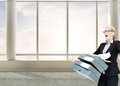 Businesswoman dropping many folders composite image of in bright d room with windows Stock Photography