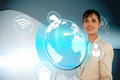 Businesswoman with earth and app interface digital composite of Stock Photos