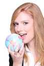 Businesswoman eating the world young Royalty Free Stock Photos