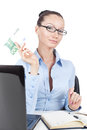 Businesswoman with euros banknote in hand on workplace Stock Photo