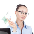 Businesswoman with euros banknote in hand on workplace Royalty Free Stock Photography