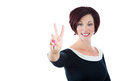 businesswoman, executive, successful woman in a black dress, showing a victory sign Royalty Free Stock Photo