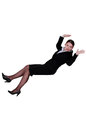 Businesswoman falling backwards into a void Stock Photo