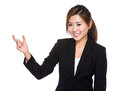Businesswoman with finger gap for hold small thing isolated on white background Royalty Free Stock Photo