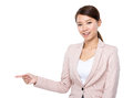Businesswoman with finger point aside isolated on white background Royalty Free Stock Photos