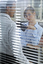 Businesswoman flirting with his colleague in office Royalty Free Stock Image