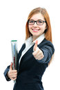 Businesswoman with a folder smiling and showing thumbs up against white background Royalty Free Stock Photo