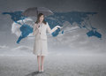 Businesswoman in front of blue map Royalty Free Stock Photo