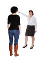 Businesswoman giving reprimand to worker. Stock Photos