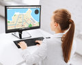 Businesswoman with gps navigator map on computer Royalty Free Stock Photo