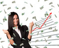 Businesswoman and graphical chart under money rain on isolated white background Royalty Free Stock Images