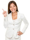 Businesswoman with hand on hip pointing sideways portrait of happy young over white background Royalty Free Stock Photos