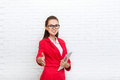 Businesswoman handshake, hold hand welcome gesture wear red jacket glasses Royalty Free Stock Photo