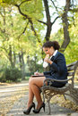 Businesswoman having breakfast in the park Royalty Free Stock Photo