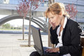 Businesswoman having a conversation outdoors Royalty Free Stock Photography