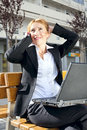 Businesswoman having a conversation outdoors Royalty Free Stock Photo