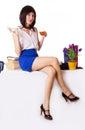 Businesswoman having tea break sitting on table attractive over white Royalty Free Stock Photo