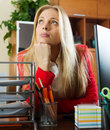 Businesswoman having a tedious time at office in red Stock Photography