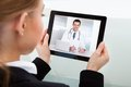 Businesswoman having video chat close up of a with doctor Royalty Free Stock Photo