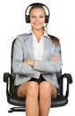 Businesswoman in headset sitting on office chair Royalty Free Stock Photo