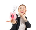 Businesswoman with her savings in a piggy bank Stock Photo