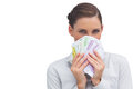 Businesswoman hiding behind money in her hand on white background Royalty Free Stock Photos
