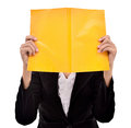 Businesswoman hiding her face behind a book isolated on white background Royalty Free Stock Photography
