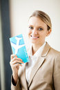 Businesswoman holding air ticket Royalty Free Stock Photo