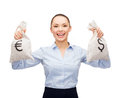 Businesswoman holding bags with dollar and euro business money concept young money Royalty Free Stock Photo