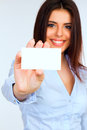 Businesswoman holding a blank card with smile Stock Photos
