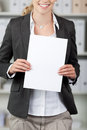 Businesswoman holding blank paper portrait of in office Stock Images