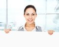 Businesswoman holding a blank white card board signboard showing an empty bill young business woman happy smile in modern Stock Images