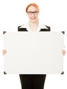Businesswoman holding blank whiteboard sign. Stock Image