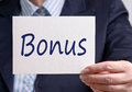 Businesswoman holding bonus sign Royalty Free Stock Photo