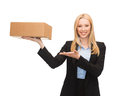 Businesswoman holding cardboard box Stock Images