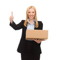 Businesswoman holding cardboard box and showing thumbs up Royalty Free Stock Image