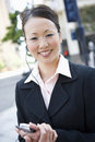 Businesswoman Holding Cell Phone Royalty Free Stock Photo