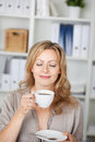 Businesswoman holding coffee cup in office closeup portrait of Stock Images