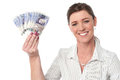 Businesswoman holding fan of currency notes woman showing british pound Stock Image
