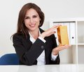 Businesswoman Holding Gold Bar Stock Photos