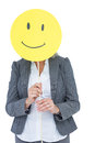 Businesswoman holding happy smiley face