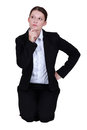 Businesswoman holding her chin thinking and Royalty Free Stock Photo