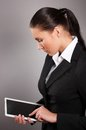 Businesswoman holding her digital tablet pc Royalty Free Stock Image