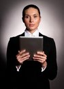 Businesswoman holding her digital tablet pc Stock Photos