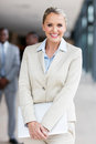 Businesswoman holding laptop pretty in office Stock Photos