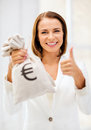Businesswoman holding money bag business and concept young with euro Stock Image