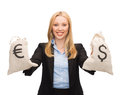 Businesswoman holding money bags with euro Royalty Free Stock Photo