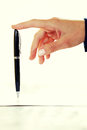 Businesswoman holding pen a with her finger Royalty Free Stock Image
