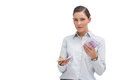 Businesswoman holding wads of cash and looking at camera on white background Royalty Free Stock Photography