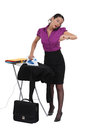 Businesswoman in a hurry ironing her suit Royalty Free Stock Images